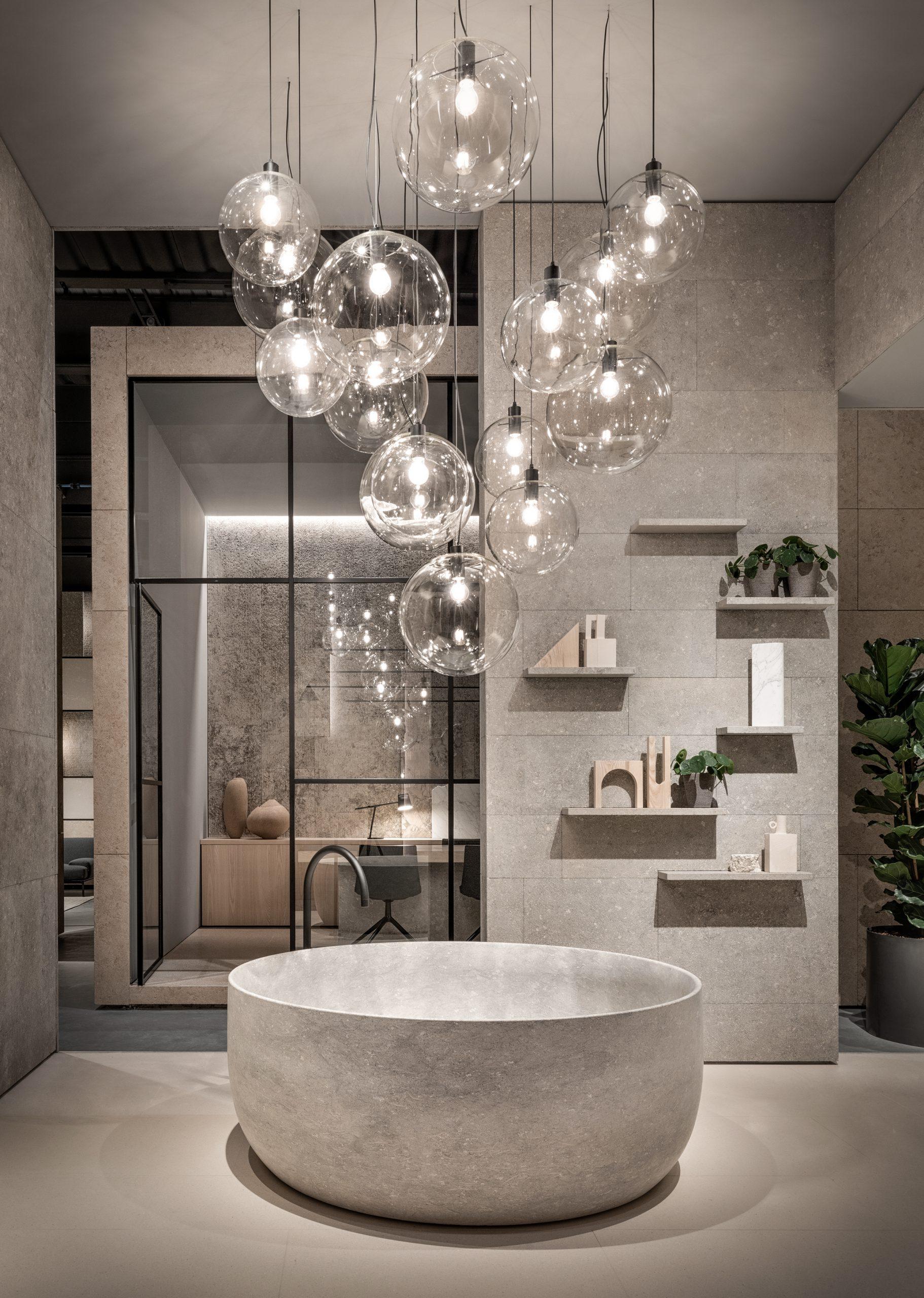 Freestanding Pietra di vicenza bathtub in Grassi Pietre's showroom designed by Debiasi Sandri