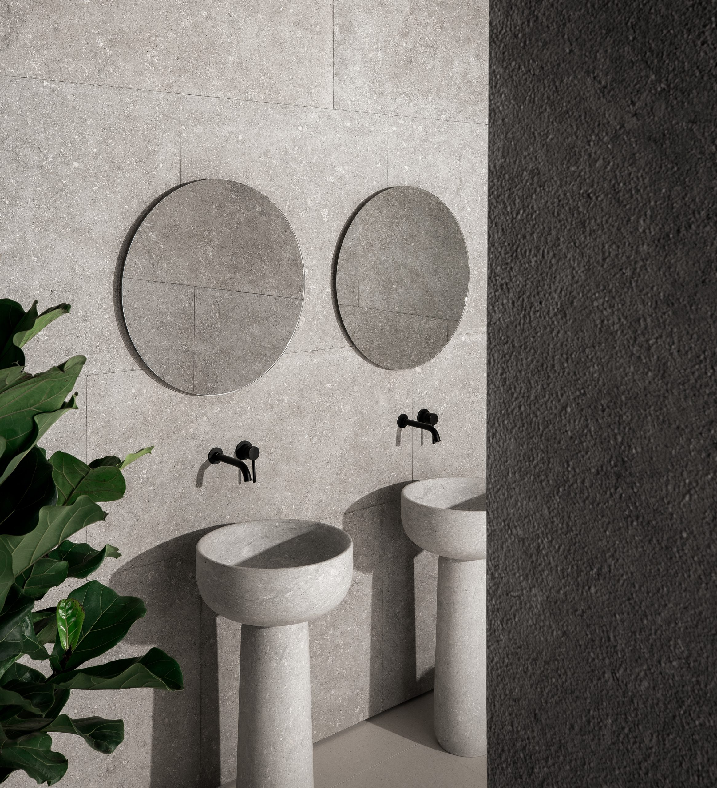 Two freestanding Tetide washbasins made from Vicenza stone, designed by Debiasi Sandri for Grassi Pietre