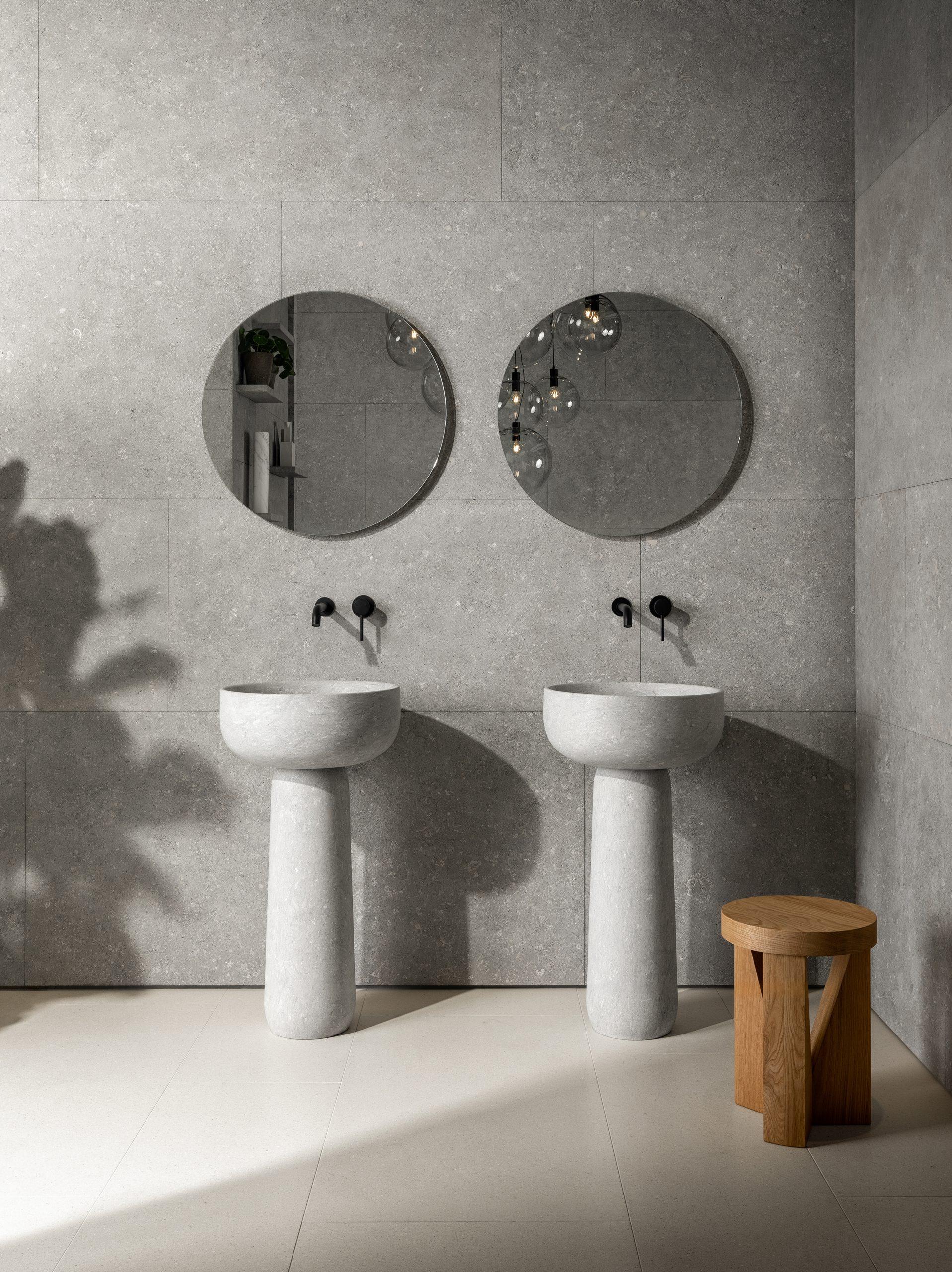 Two freestanding Tetide washbasins in Vicenza stone, designed by Debiasi Sandri for Grassi Pietre