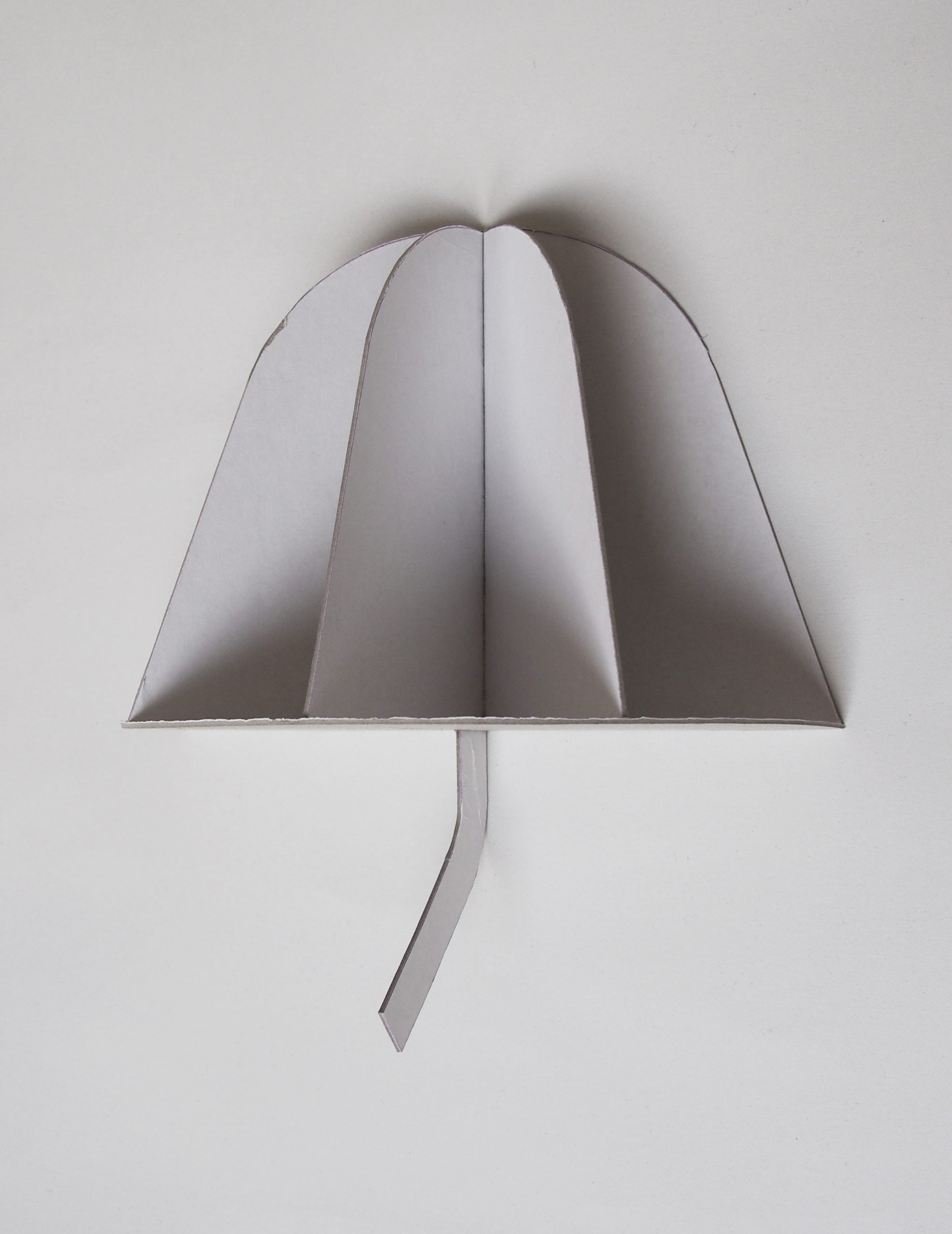 Mockup of the Enoki, designed for Penta, is a wall sconce characterised by two simple and harmonious elements: a protruding semidome mounted on a plane that recalls the object's shadow.